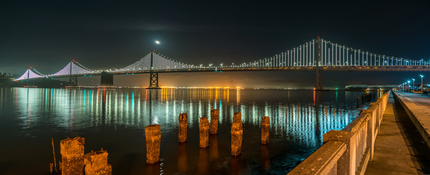 Wide Angle Panorama of the Oakland Bridge at Night from Downtown San Francisco