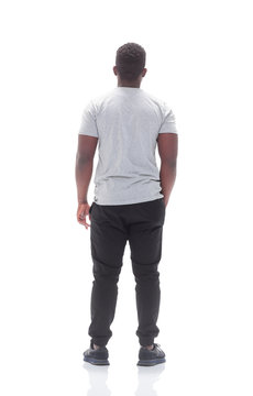 rear view. young man looking at white blank screen.