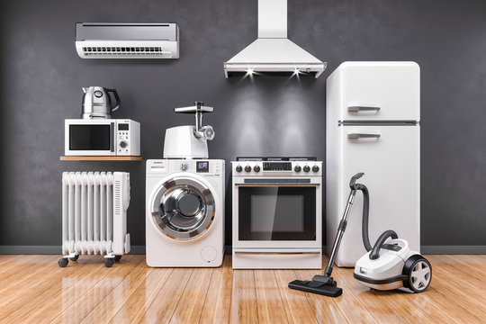 Set of home kitchen appliances in the room on the wall background