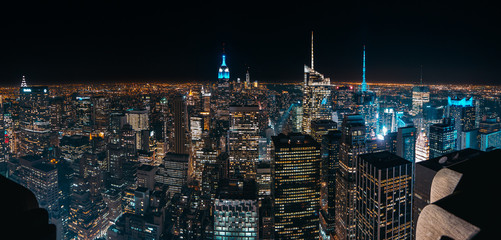 Foto auf Leinwand New York Amazing panorama view of New York city skyline and skyscraper at Night. Beautiful night view in Midtown Manhattan.