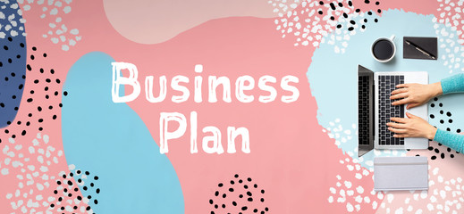 Business plan with person using a laptop computer