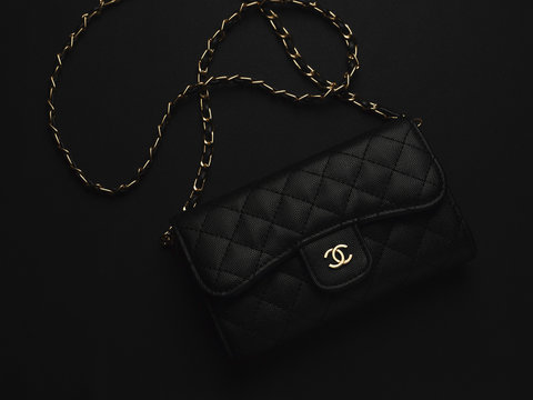 Black Chanel leather bag with golden chain