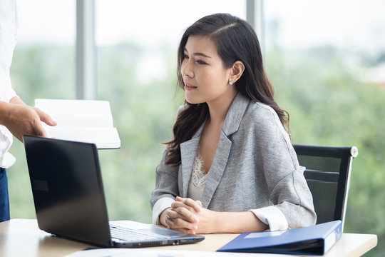 asian attractive mature businesswoman working on laptop in office.
