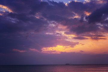 Fototapete - Bright magical sunset over the sea, golden purple and pink tones. Fluffy clouds