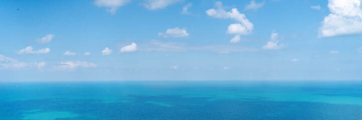 Fototapete - Panorama banner format. Beautiful stunning vibrant landscape, blue sea and sky with white clouds, aerial view of the sea