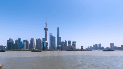 Wall Mural - time lapse of shanghai skyline in sunny afternoon by huangpu riverside, China