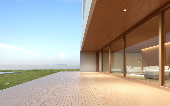 Perspective of modern luxury building with wood terrace and grass field on sea view background,double floor of housing with metal roof design. 3D rendering.