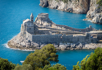 Porto Venere (Portovenere), Liguria, Italy: beautiful aerial scenic view of the Church of St. Peter (Chiesa di San Pietro) from Palmaria Island nearby Cinque Terre with Byron grotto Fotomurales