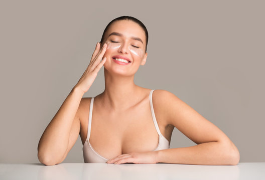 Happy woman with collagen pads under eyes