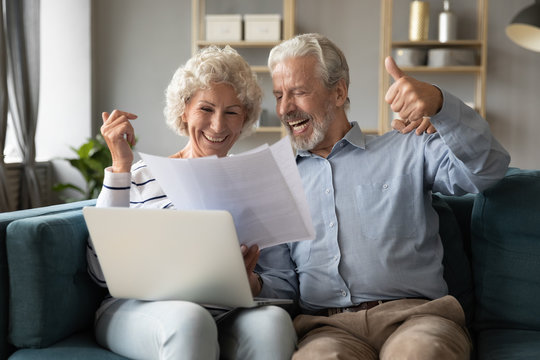 70s spouses check documents feels happy about pay debt off