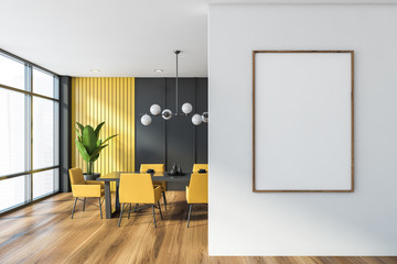 Gray and yellow dining room with poster