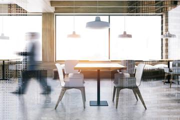 Man walking in white and wooden restaurant