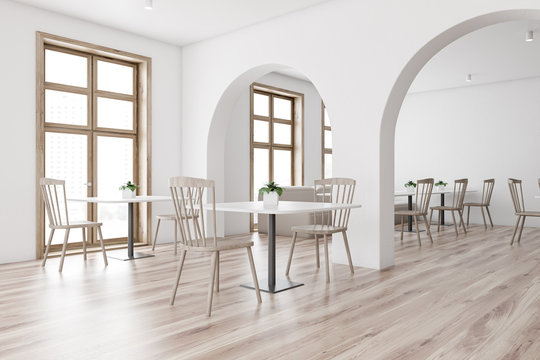 White restaurant corner with arches and sofa