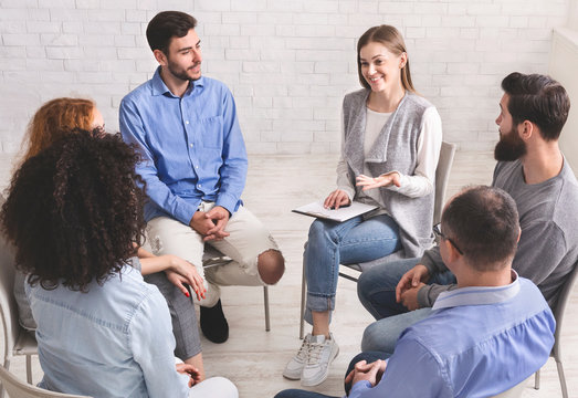 Psychotherapist talking with patients of support group