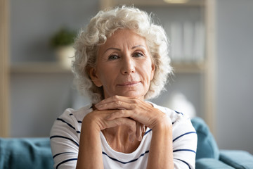 Headshot portrait mature woman posing looking at camera