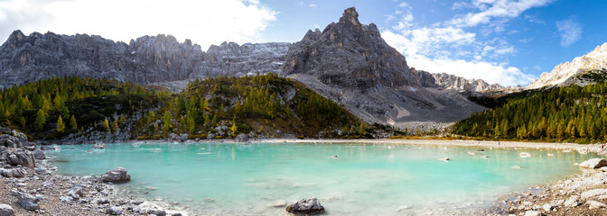 Panoramic view to Sorapis Lake, an unbelievable turquoise and azure lake in the heart of the Dolomites near Cortina D'Ampezzo. Italy, South Tyrol.