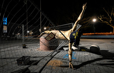 The statue of soccer player Zlatan Ibrahimovic is seen sawn down and destroyed, at the square next to football arena in Malmo