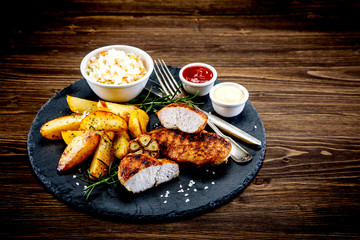 Grilled chicken fillet with baked potatoes and vegetables