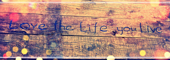 Positive inspiring quote written carved  in wood Love the life you live. Best motivational quotes, inspirational quotes and sayings about life. Motivation, and inspiration image quote