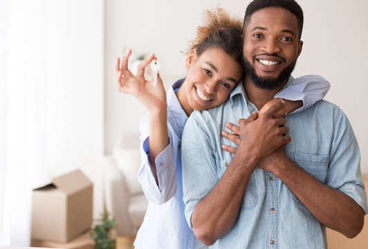 Afro Spouses Showing Key To Camera Embracing In New Home