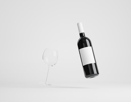 Wine bottle floating in air and a wine glass standing on white background. Label clipping path included. 3D render