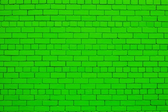 Pure green color painted brick wall.