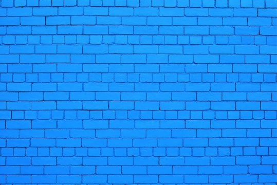 Blue color painted brick wall.