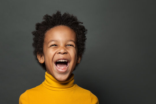Little boy black child laughing. Closeup portrait