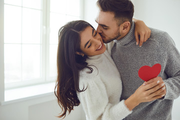 Valentine's day. Couple gives heart to the Valentine's Day in the room.