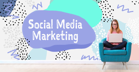 Social media marketing with young woman using her laptop in a chair