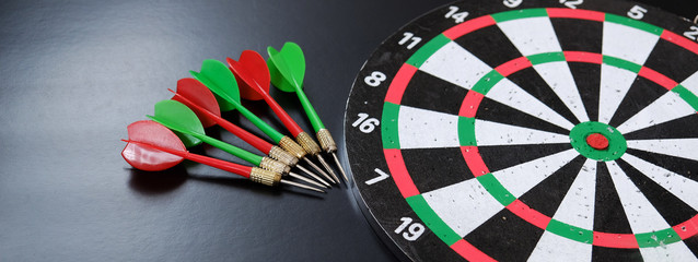 dart sports branch, dartboard and colorful dart arrows on black ground,