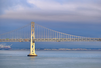 Fototapete - Light on Bay Bridge with Blue Cloudy Sky