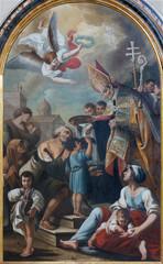 CATANIA, ITALY - APRIL 7, 2018: The paintng of St. Thomas of Villanova in church Chiesa di San Agostino by Giuseppe Zacco (1809).