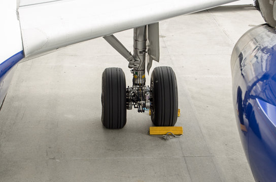 Chocks securing a plane undercarriage.