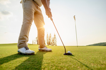 lifestyle, golf, activity, outdoor, sport, golfer concept. Golf balls that are going to be hole by golfers at the green grass golf course at sunset.