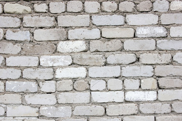 White brick wall. The texture of the old brick. Old masonry. Background.