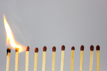 line of matches igniting in a chain reaction