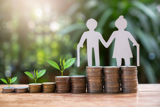 old couple model standing on money coins saving for concept investment mutual fund finance and pension retirement