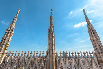 Fototapete - Milan Cathedral roof, Italy. Famous Milan Cathedral or Duomo di Milano is a top tourist attraction of Milan.