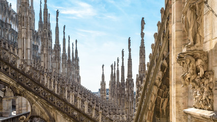 Fototapete - Milan Cathedral or Duomo di Milano, Italy. Panoramic view of luxury roof. Famous main church of Milan is a top tourist attraction of city.