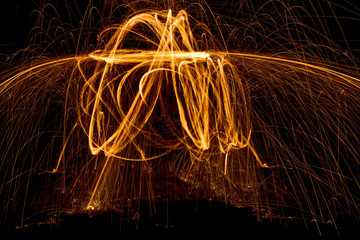 Light Painting with Party Sparkler Isolated on Black Background