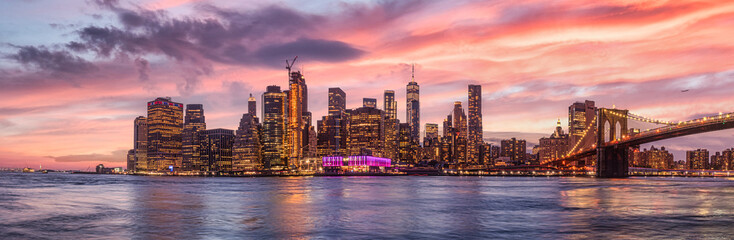 Photo sur Toile New York new york city skyline travel destination at dramatic sunset over manhatten