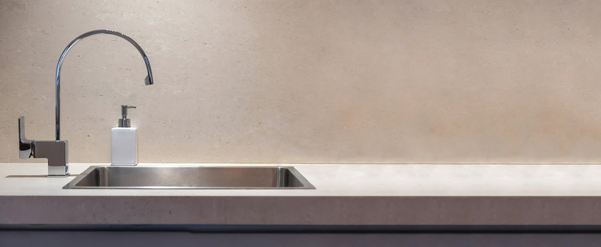 Kitchen sink and water tap banner, copy space, front view.