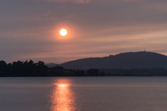 Smoke induced orange sky at sunrise over New Zealand caused by 2010/2020 Australian wildfires