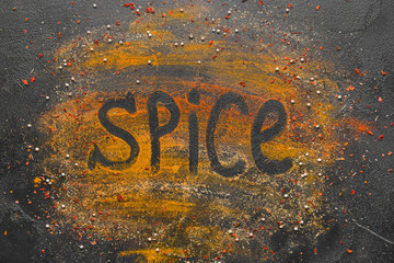 Composition with different spices on dark background