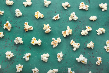 Tasty popcorn on color background
