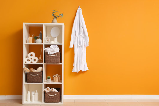 Body care cosmetics with accessories on rack in bathroom