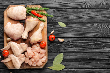 Foto op Canvas Kip Composition with raw chicken meat on wooden background