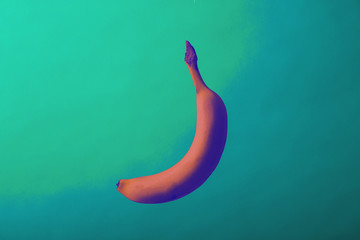 fresh banana with funky colors on blue and green background