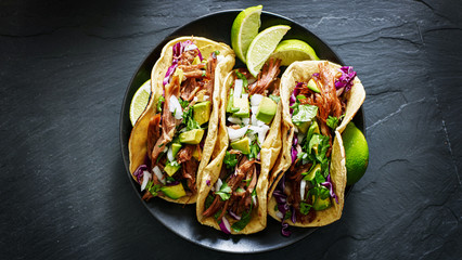 Sticker - mexican street tacos flat lay composition with pork carnitas, avocado, onion, cilantro, and red cabbage